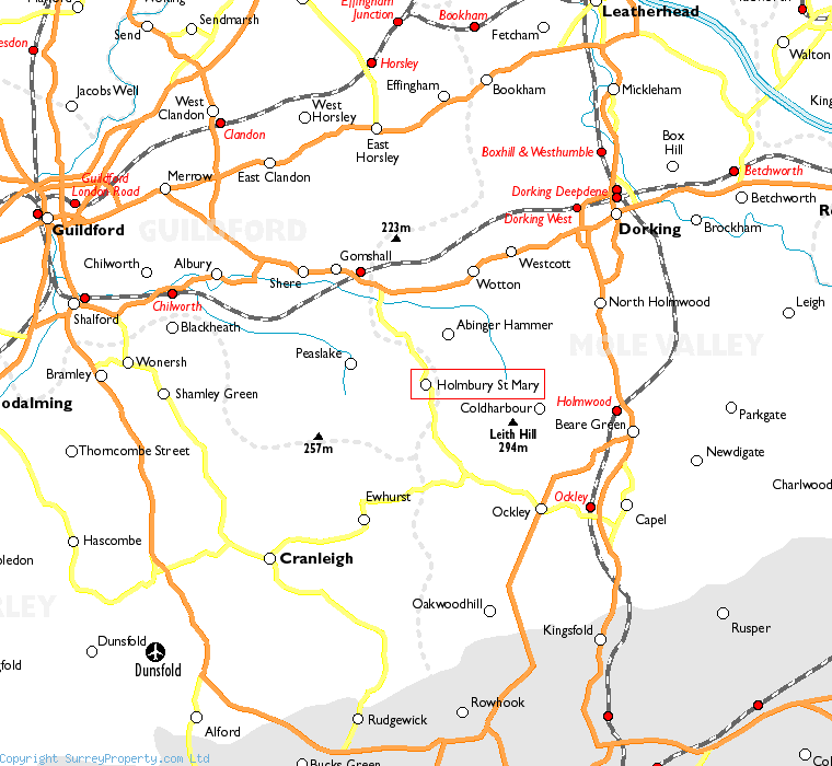 Holmbury St Mary in relation to neighbouring towns