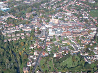 Aerial photograph of Leatherhead town centre from the south, church of St Mary and St Nicholas in the foreground