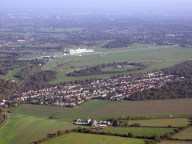 Aerial photograph of View over Epsom Downs to racecourse