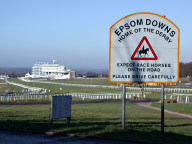 Sign and racecourse grandstand, Tattenham Corner