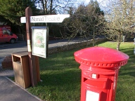 Sign and postbox, East Horsley