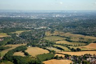 Aerial photograph of View to Croydon, City of London, Canary Wharf and Millennium Dome