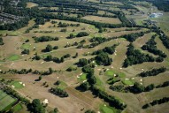 Aerial photograph of Golf course and Epsom Downs racecourse
