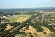 Aerial photograph of Esher railway station and Sandown Park racecourse