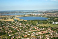 Aerial photograph of View over Weston Green to reservoirs