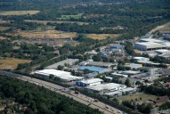 Aerial photograph of M25 and industrial park at Byfleet