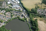 Aerial photograph of Coxes Lock mill and millpond, Addlestone