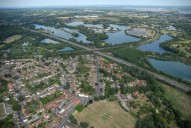 Aerial photograph of Chertsey outskirts and Thorpe lakes