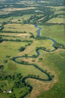 Aerial photograph of Woking Palace, Newark Priory (middle distance) and the River Wey near Old Woking
