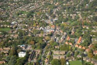 Aerial photograph of Bookham town centre including St Nicolas Church
