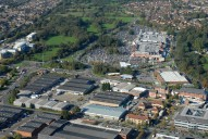 Aerial photograph of Industrial park and The Meadows supermarkets